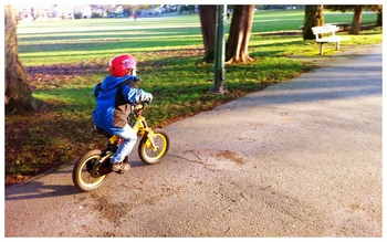 Aidan pedalling on two wheels, February 2011